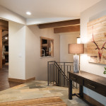 The entry is on the second level of them home and features quartzite flooring and quick access to the rest of the home.
